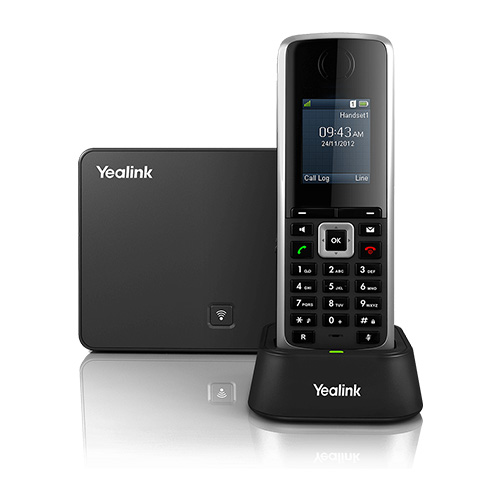 Yealink W52P DECT handset straight on charging in a docking station in front of DECT base